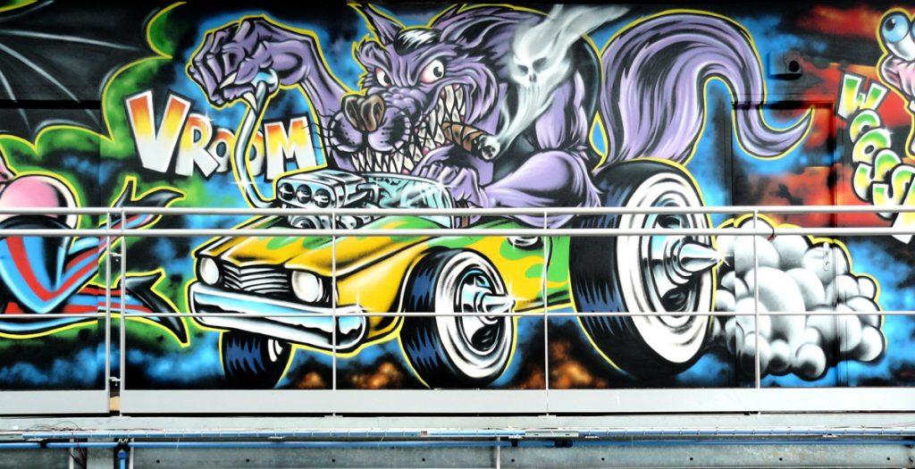 """Fresque décorative de 2,5 x 15 m réalisée pour le garage """"Graffi Bike Concept"""" à Périgny (17), sur le thème du Rock'n Roll / Monster."""