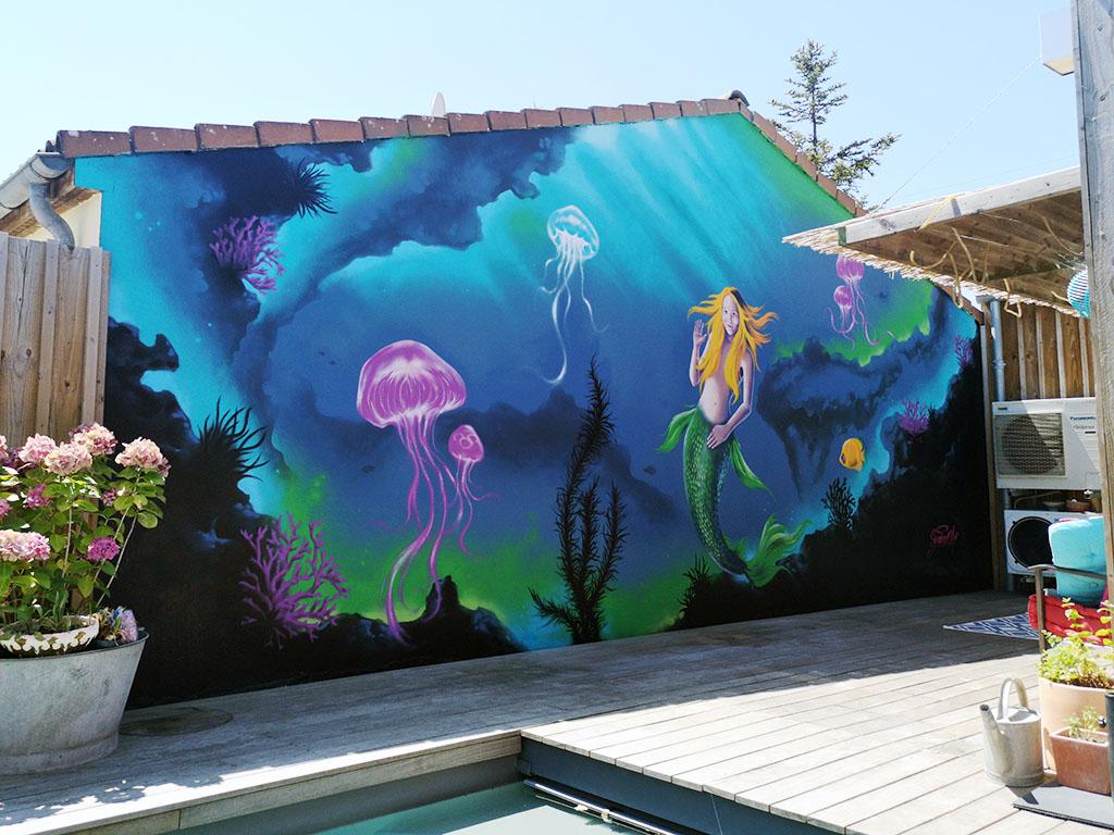 Fresque murale réalisée à l'aérosol et pinceaux